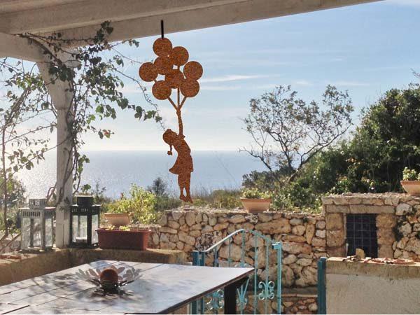 ornamenti-decorazioni giardino in corten